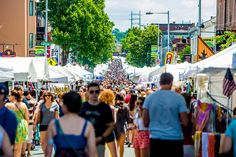 Thousands pack Main Street in Philadelphia's Manayunk neighborhood for a weekend of arts, crafts, food and fun during the annual Manayunk Arts Festival, happening June 25-26, 2016. (Photo courtesy J. Fusco for Visit Philadelphia)