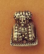 Figure from Gnezdovo hoard, may be wearing a highly decorated front panel. Link goes to Viking Girl Image Resources on Flickr - lots of great reference pictures!