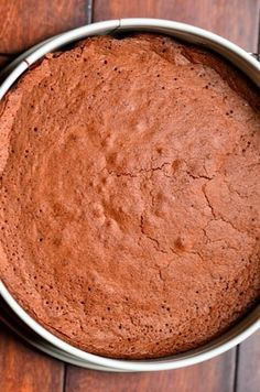 This Dark Chocolate Flourless Cake recipe is perfect for holiday entertaining and the gluten-free crowd!