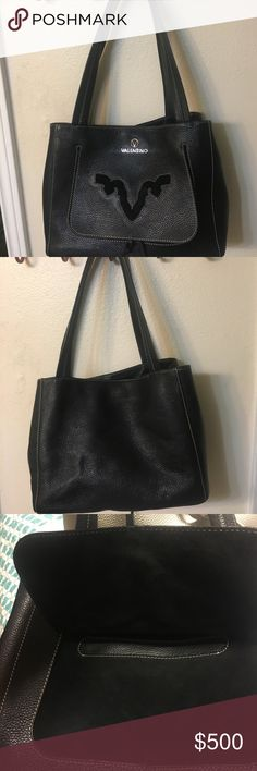 "Authentic Valentino Tote Authentic black leather with suede V Valentino Tote. Has 3 inside compartments & middle one zips plus zipper inside slot. Outside compartment also.  Straps 23""  14 . 6 x 6.5 Valentino Bags Totes"