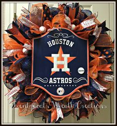 Houston Astros deco mesh wreath complete with MLB Astros sign and accented with baseballs and ribbon.  Created by Twentycoats Wreath Creations (2016)