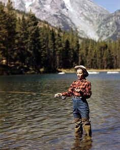 A woman in plaid trout fishing in String Lake in the Grand Teton National Forest, in Wyoming - 1948. (Alfred Eisenstaedt—The LIFE Picture Collection/Getty Images)