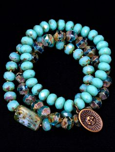 Three strands of unique turquoise stretch bracelets with antiqued Kabela charm and unique carved Czech crystal. Rondelle shapes may vary