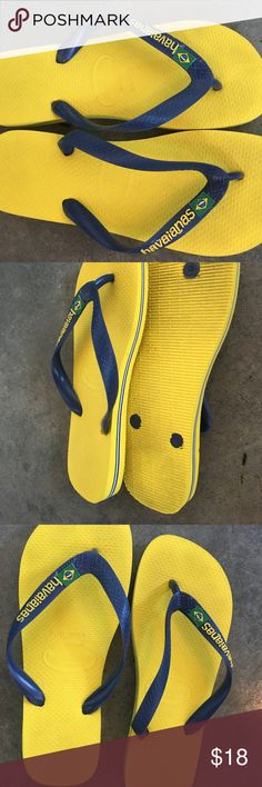 Havaianas Brazil Logo Citrus Yellow Flip Flops Authentic Brazilian Flip Flops in GUC! Worn 1x Bright Yellow with Dark Navy Blue Strap Comfy, supportive and quality - I just moved somewhere cold and haven't worn these since June Havaianas Shoes Sandals