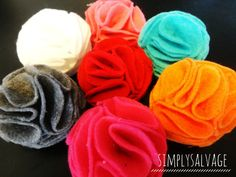 DIY Felt flower tutorial. This is made with hot glue, I think it might be nicer if you'd see the felt circles to the base. And if you put two of these back to back, you'll have a cute pom-pom.