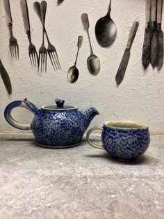 Kyriaki Gerontaki, Kiki ceramics, Stoneware Teapot and tea cup made on the potter's wheel, carved and glazed , fired at 1250 oc oxidation
