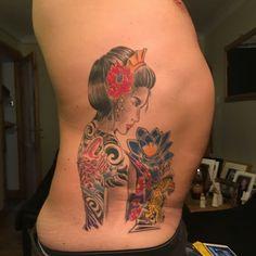 Geisha tattoo on ribs .