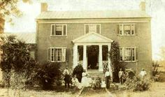 "Newlyweds, Anna Mary Robertson Moses (later known as Grandma Moses) and her husband, Thomas, arrived in Augusta County, Virginia, from upstate New York in 1887, renting several farms before purchasing ""Mount Airy,"" a large brick Federal style house built in 1830. The family gained renown for their butter, milk and potato chips. There are three known paintings titled ""Mount Airy"" depicting the house and farm. This photo depicts the Moses family during the early years of their Virginia…"