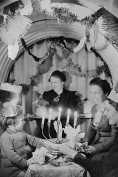 A Christmas celebration in an Anderson shelter.