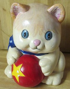 Kitten Piggy Bank I painted for my granddaughter about 10 years ago.he's showing a little wear and tear but still very cute
