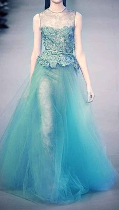 21 Breathtaking Couture Gowns Fit For An Ice Queen | This reminds me of what it looks like to see someone swimming underwater. It's beautiful.