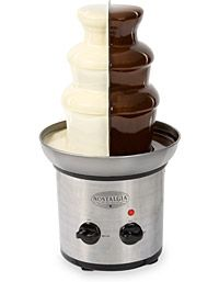 Tanner's chocolate fountain,  love how it is half white chocolate and half milk chocolate!! :)