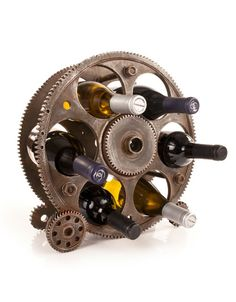 Gears and Wheels Bottle Rack for $65.00 from WineRacks.com   Gears and Wheels Bottle Rack $65.00  The Gears & Wheels Bottle Holder was designed to fit any home theme with its trendy, industrial chic style. Perfect for displaying or storing 6 standard sized bottles.      Holds 6 bottles     Solid Construction