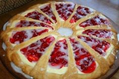 Easy desert made with crescent roll dough, cream cheese and canned pie filling. Omg