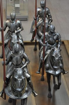 Equestrian grouping in center of main armor gallery.