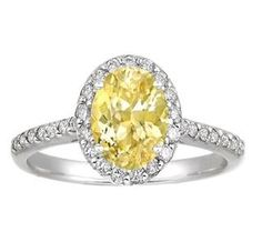 Sapphire Fancy Halo Diamond Ring set with a stunning oval 8x6mm yellow sapphire.