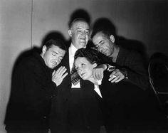 Peter Lorre, Sydney Greenstreet, Mary Astor & Humphrey Bogart share a group hug on the set of 'The Maltese Falcon' (1941)