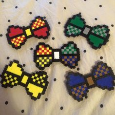 Perler Bead hair bows / bow ties ( Harry Potter house themed )  https://instagram.com/mugglemerch/