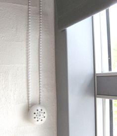 Kreativ indretning: Alternativ gardinsnor-holder