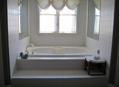 Tub to removed & replaced with large walk-in shower.
