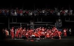 Andreas Gursky. I really like the contrast between the busy Ferrari pit team and the crowd.