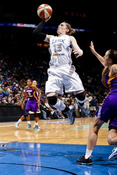 Lindsay Whalen flying through the air....ACTION SHOT
