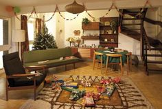 Deck the ceilings: A living room in 1965 saw the arrival of paper chains tinsel wrapped around a tree