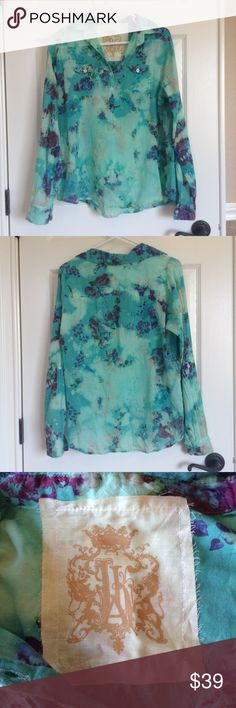 JAK Printed Soft/Thin Cotton Blouse from Saks JAK Blouse from Saks. Printed cotton is a pretty teal with purple, green, blue and cream floral designs. 5 collar buttons and button front pockets. Long sleeve with button cuffs. Super soft, thin cotton. JAK Tops Blouses