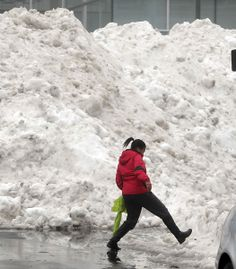Image result for images of snow piles in mall parking lot