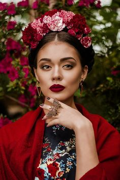 Frida Kahlo flowers in braids makeup dark maroon lips