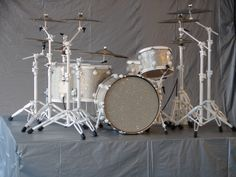 DW, Truth, or any top brand - anything with white, one rack tom and two floor toms. Don't want these cymbals and stands.