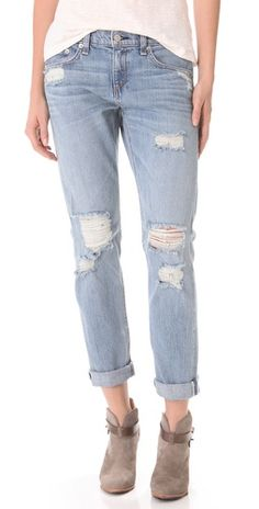 Rag & Bone/JEAN The Boyfriend Jeans Shredded holes and whiskering lend a lived-in look to a pair of faded, 5-pocket boyfriend jeans. Frayed cuffs finish the well-worn silhouette. Single-button closure and zip fly.