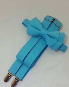Blue Box Suspenders and Blue Box Bow Tie. Bridal Color Blue Box. Sizes Infant-Adult. Free Fabric Sample Available. Blue Groomsmen, Groomsmen Suspenders, Suspenders For Boys, Free Fabric Samples, Free Fabric Swatches, Groomsmen Accessories, Popular Wedding Colors, Ring Bearer Outfit, Blue Bow Tie