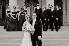 Group photo of the wedding party on the steps of the state capitol in Lansing, MI. www.HolmesPhotography.biz