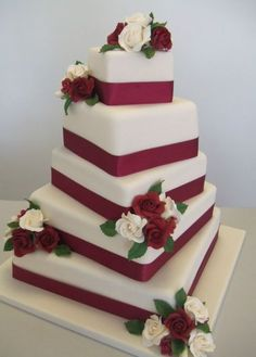 Five tier wedding cake with red ribbons and white and red roses.JPG