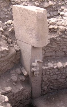Typical t-shaped pillar, with carving, approximately 11,000 years old, Gobekli Tepe, Turkey.