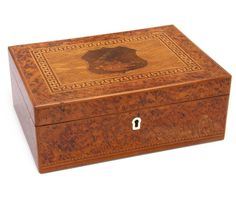 A William Seuffert inlaid New Zealand timber jewellery box central heraldic crest to top surrounded by 'Key' border.  -  Carter's Price Guide to Antiques and Collectables