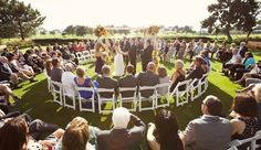 Outdoor Wedding Ceremony Seating: Seating in the round is a great idea when you're contending with many guests and a vast space. If you were to seat this crowd traditionally, only the first few rows would be able to hear your vows easily. Seating in the round also gives a wedding a more intimate vibe, one in which friends and family are literally surrounding the happy couple.