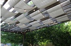 Weave strips of sail cloth through the pergola for an outdoor ceiling
