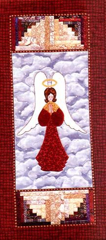 Too bad I'm not really a quilter. My eldest daughter would love this little quilted wall hanging.