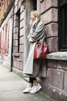 Camille Charriere is wearing a is wearing a grey long coat coat from Christophe…