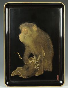 Tray with monkey imag. Japan. ca. 1775-1850 Shiomi Masanari (Artist). Wood covered in <i>roiro</i> (highly lustrous) black lacquer with gold and red <i>togidashi maki-e</i> (polished out flat sprinkled picture) lacquer, with a thin gold border all round the upper edge.
