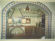 This is sort of what we're going for with the tiles around our doorway. No arch though. Just square.