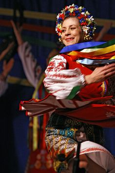A dancer in the Ukraine-Kyiv pavillion at Maples Collegiate - this is a traditional folk costume.
