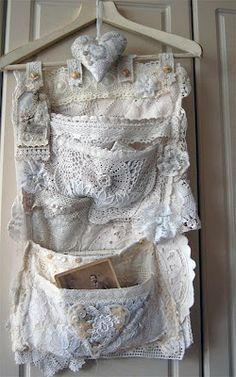 """lace """"holder"""" on hanger -- I just can't pass up old lace doilies ... what a great idea to use them ... perfect for the ones that have a little stain or tear!"""
