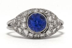 The Santa Ynez Antique Art Deco Sapphire Engagement Ring. Crossing over from the Edwardian era, the platinum bombe' dome setting is encrusted with 3/4 carats of sparkling old European diamonds. Topped with the most vibrant, shimmering shade of blue with captivating brilliance and exceptional clarity. #bluesapphire #platinum #artdeco #engagementring #artdecorings #artdecoring #engagementrings #heirloom #heirloomring #heirloomrings #ido #love #bluesapphires #platinumring #antique #antiquering Estate Engagement Ring, Filigree Engagement Ring, Antique Engagement Rings, Vintage Diamond Rings, Diamond Art, Antique Rings, Antique Art, 1 Carat, Edwardian Ring