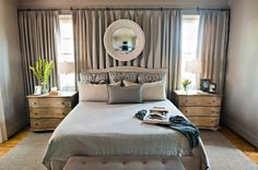 What a great idea for a contemporary bedroom that has awkward windows!  by Dana Wolter