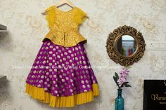 Stunning purple brocade lehenga and yellow color peplum top Get your little one dolled up Time for some bright colors !whatsapp 9121017226 26 November 2018 is part of Dresses kids girl - Kids Party Wear Dresses, Kids Dress Wear, Kids Gown, Dresses Kids Girl, Kids Outfits, Children Dress, Baby Dresses, Dress Party, Kids Wear