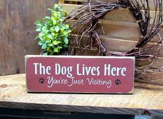The Dog Lives Here You're Just Visiting. This Wooden Sign is painted Barn Red…