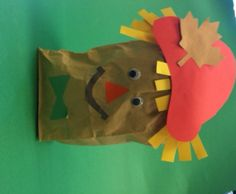 """Preschoolers can easily assemble this brown paper bag scarecrow. Scarecrow """"parts"""" can be cut out of construction paper ahead of time. Stuff the brown bag with newspaper and tape the top over. Children choose and glue on the parts of their scarecrow. This is a great table decoration for fall holidays. #Greenwich Library #Children's #Crafts"""